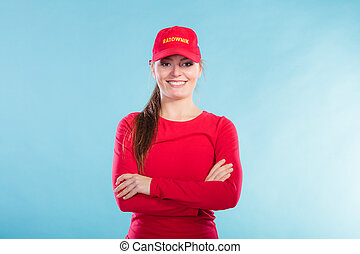 Portrait of happy lifeguard woman in red cap. - Portrait of...