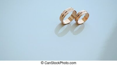 closeup of wedding rings on table