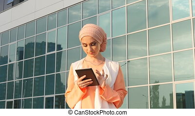 Muslim woman use tablet - muslim woman use tablet outdoor