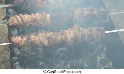 Barbecue with delicious grilled meat on the grill. Pork meat...