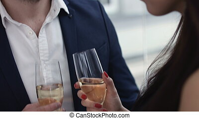 Young Couple Toasting champagne In Restaurant Dating Young...