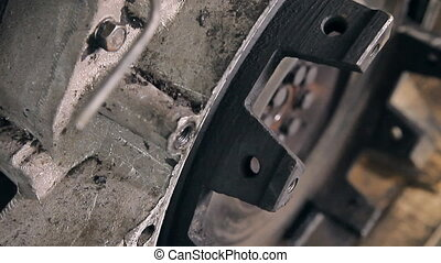 A part of an old car engine - A metal motor in the...