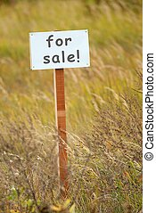For sale signboard on a piece of ground
