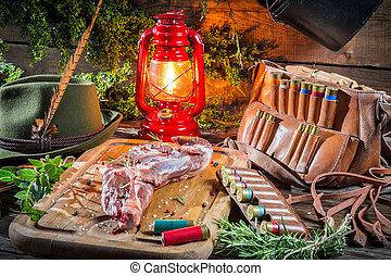 Fresh venison prepared for roasting in hunter lodge