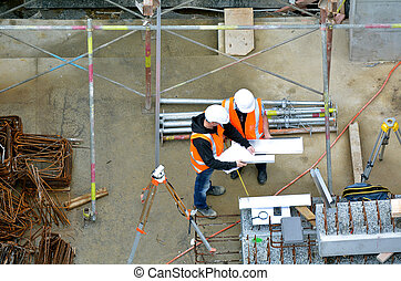 Civil engineers inspecting construction site - Aerial view...