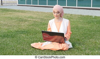 Beautiful muslim girl at park with notebook - beautiful...