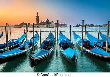 Blurred gondolas in Venice at dawn