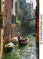 Lone gondolier in Venice Floating