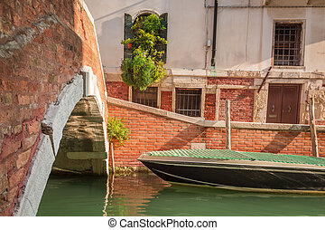 Small stone bridge over a canal in Venice