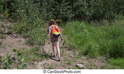 Girl with backpack - The girl with a backpack goes on a...