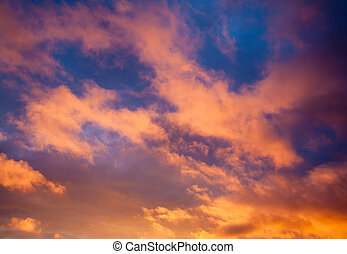 Dramatic sky with orange clouds at sunset