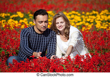 married couple in flowering park