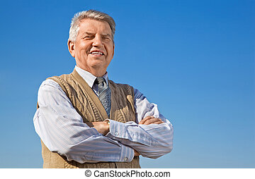 Senior man on background sky - smiling Senior man with...