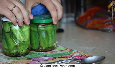 Man resets jars with vegetables