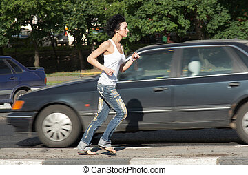 girl runs on road among cars