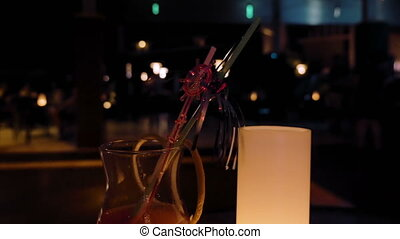 A glass filled with alcoholic beverage on a table - A glass...