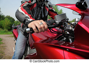 hand of motorcyclist  on country road