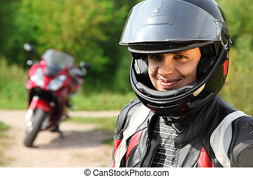 motorcyclist and his bike on country road - smiling...