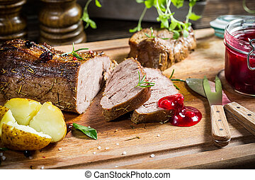 Venison with cranberry sauce and rosemary