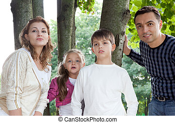 surprised family of four outdoors