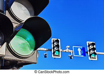 Traffic lights over blue sky. Green light