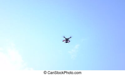 RC drone with camera flying high in the sky, 4K long shot -...