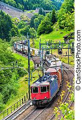 Freight train climbs up the Gotthard railway - Switzerland -...