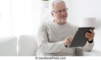 senior man with tablet pc at home 83 - technology, people...
