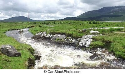 view to river and hills at connemara in ireland 35 - nature...