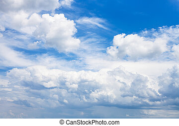 dense white clouds in blue sky in summer day, Kuban, Russia