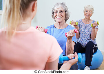 Senior Women At Fitness Class With Instructor