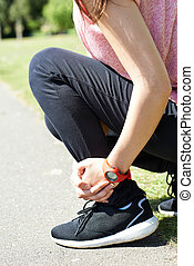 Woman With Sports Injury Sustained Whilst Jogging In Park