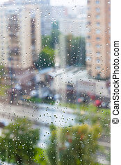 rain drops on window glass and blurred street on background