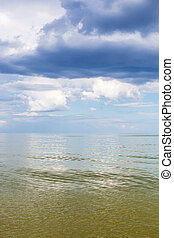 Azov Sea waterscape with green water and blue sky - natural...