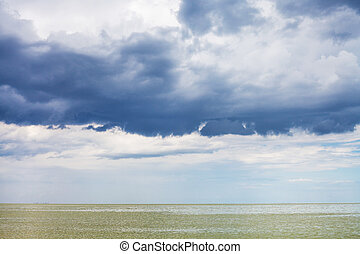 dark blue storm clouds over Sea of Azov, Temryuk bay,...