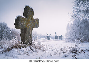 Old stone cross on grave - Old stone cross. Burial at the...