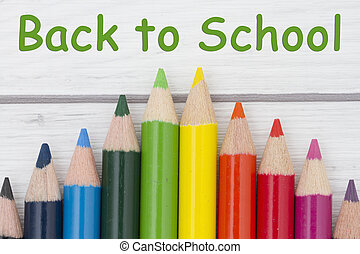 Pencil Crayons with text Back to School with weathered wood...