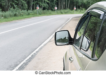 mirror of a car on the road background