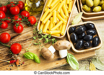 Italian pasta ingredients with mushrooms,tomatoes,olives,herbs and spices