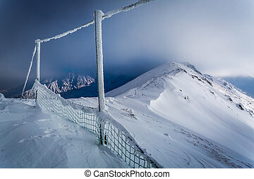 Mountain peak covered with snow in winter