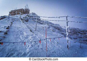 Frozen meteorological station in the mountains in winter