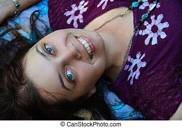 girl is lying on her back - Girl brunette in dark purple...