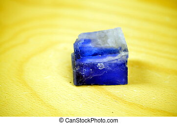 blue and white salt halite crystal with wooden background
