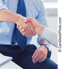 businessmen shaking hands in office - businesss and office...