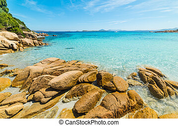 yellow rocks and turquoise water in Sardinia, Italy