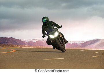 young man riding big motorcycle on asphalt highway ,use for...