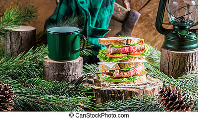 Homemade beef sandwich and coffee for breakfast woodcutter