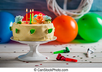 Lighted candles on birthday cake