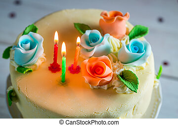 Lighted candles and birthday cake