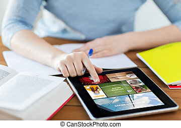 close up of woman with internet news on tablet pc